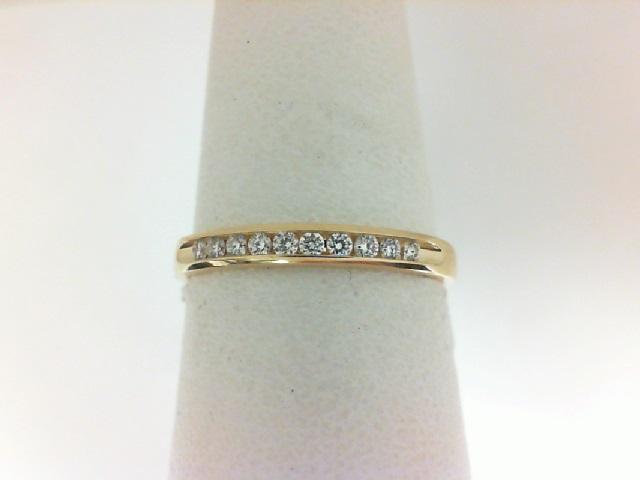 14 karat yellow gold 1/10 carat tw channel band