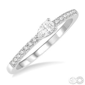 14 Karat White Gold Fashion Ring With One 0.25Ct Pear Diamond And 10.00Tw Round Diamonds