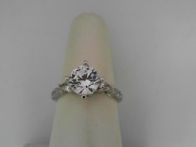 Natalie K: 14 Karat White Gold Semi-Mount Ring With 2=0.41Tw Pear Side Diamonds And 70=0.24Tw Round Diamonds Center Size: 7mm