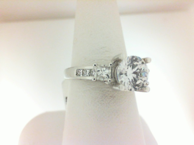 Natalie K: 14 Karat White Gold Semi-Mount Ring With 2 Princess Cut Sides and 6 Princess Cut Channel Set With Rounds on Side Profile .87Ctw Diamond  Center Size: 8mm