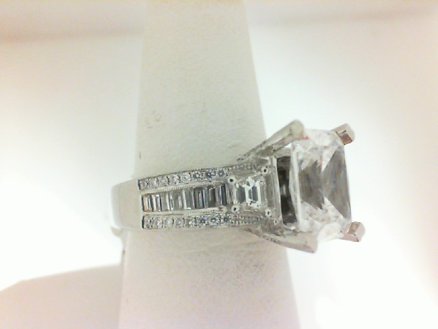 Natalie K: 14 Karat White Gold Karat Semi-Mount Ring With 2 Trapezoid Diamonds, Baguette And Round Diamonds .98Tw Center Size: 10x8mm