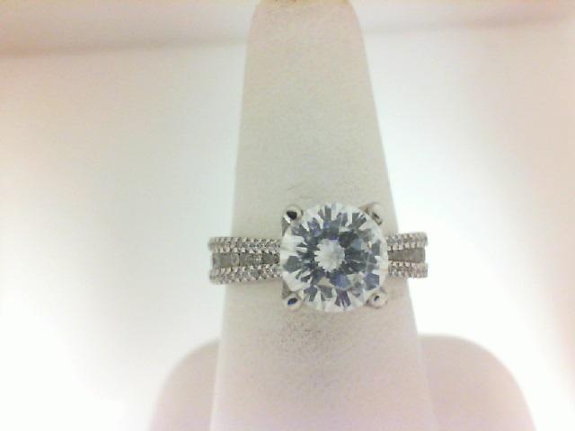 Natalie K: 14 Karat White Gold Semi-Mount  With 90=0.60Tw Round Diamonds Serial #: 488485 Ring Size 6.5
