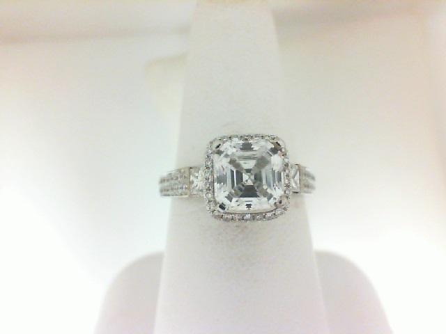 Natalie K: 14 Karat White Gold Halo 3 Stone Semi-Mount Ring With 64=0.33Tw Round Diamonds And 2=0.24Tw Princess Diamonds Serial #: 481605  Ring Size 6.5