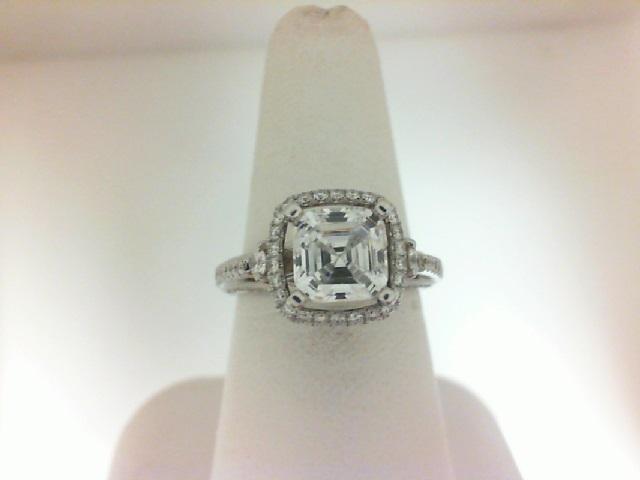 Natalie K: 18 Karat White Gold Halo Semi-Mount With 94=0.54Tw Round Diamonds Center Size: 1.5CT Serial #: 469054 Ring Size 6.5