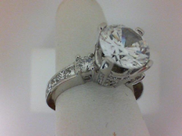 Natalie K: 14 Karat White Gold Semi-Mount Ring With 2=0.27Tw Side  Round Diamonds, 10=0.68Tw Channel Set Princess Diamonds And .09 Twt Round Diamonds Center Size: 8.5mm