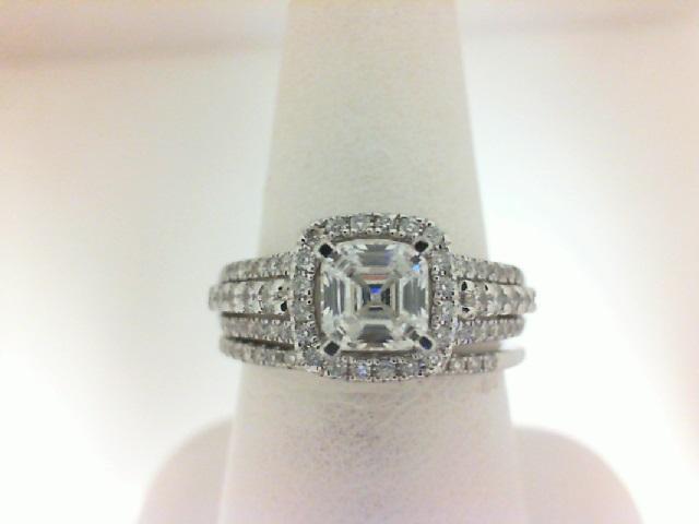 Natalie K: 14 Karat White Gold Halo Semi-Mount Ring Size 6.5 With 97=0.60Tw Round Diamonds Serial #: 524372 Center Size: 6mm