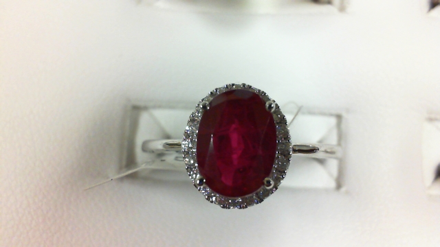 14 Karat White Gold Fashion Ring With 20=0.13Tw Round Diamonds And One 1.59Ct Oval Created Ruby