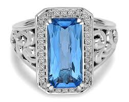 Charles Krypell: Sterling Silver Fashion Ring With One 15.00X7.00mm Emerald Cut Swiss Blue Topaz And 34=0.34Tw Round Diamonds