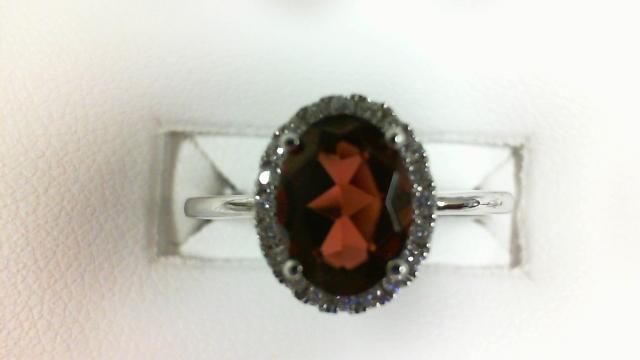 14 Karat White Gold Fashion Ring With 20=0.13Tw Round Diamonds And One 1.20Ct Oval Garnet