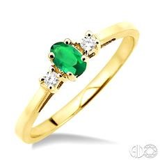 10 Karat Yellow Gold Fashion Ring With One 5.00X3.00mm Oval Emerald And 2=0.06Tw Round Diamonds