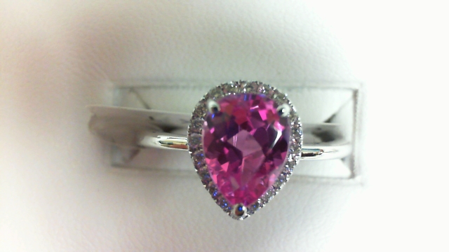 14 Karat White Gold Halo Ring With 20 Round Diamonds At 0.13Tw  And One  Pear Pink Topaz At 1.50Ct