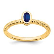 14 karat yellow gold oval bezel set sapphire rope design ring