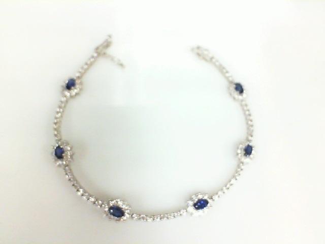 18 Karat White Gold Bracelet With 6=1.68Tw Oval Sapphires And 2.19Tw Round Diamonds Length: 7