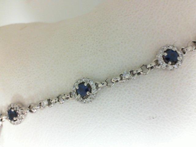 18 Karat White Gold Bracelet With 5=0.66Tw Round Sapphires And 0.53Tw Round Diamonds Length: 7.75