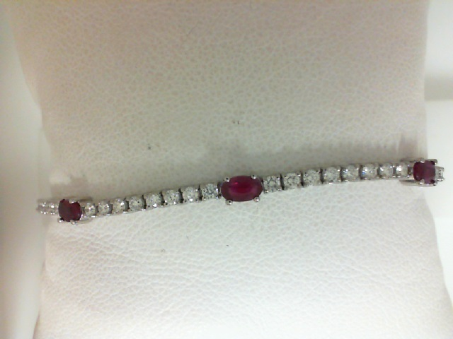 14 Karat White Gold Bracelet With 3=0.83Tw Oval Rubies And 30=0.90Tw Round Diamonds Length: 7