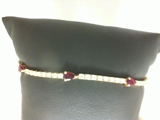 14 Karat Yellow Gold Bracelet With 3=0.78Tw Pear Rubies And 28=0.75Tw Round Diamonds Length: 7.25