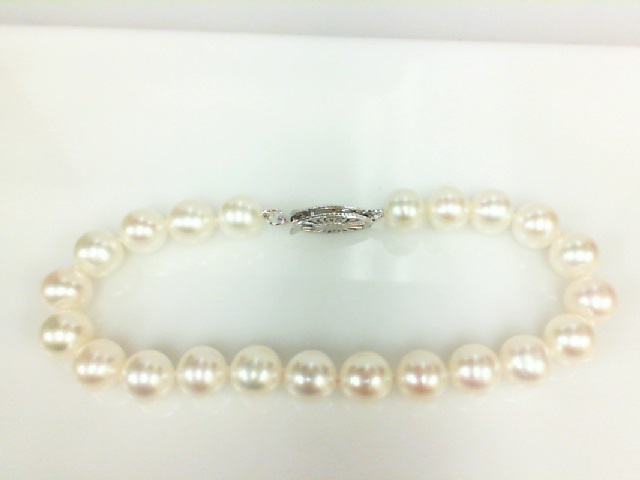 10Kt White Gold  Bracelet With 6- 6.5 00 mm Freshwater Pearls 7.5