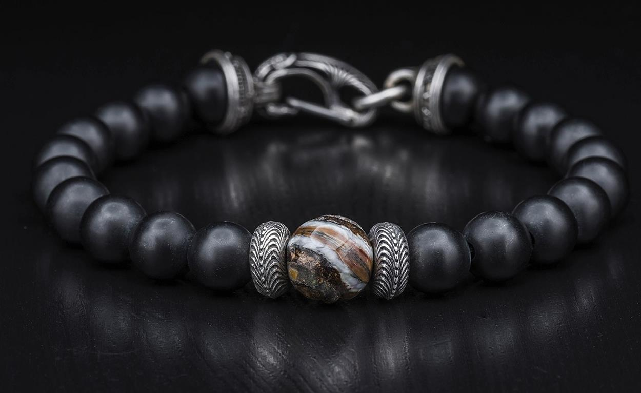 William Henry: Sterling Silver Bracelet With One 10.00mm Bead Fossil Woolly Mammoth Tooth And 8.00mm Bead Black Onyx Beads Name: Black Onyx/Fossil Wooly Mammoth Tooth Length: 8.5